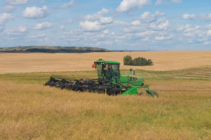 The John Deere 155 Self-Propelled Windrower offers fast cutting speeds and easy-to-maneuver controls for all types of conditions and field-terrain.Photo by John Deere International GmbH