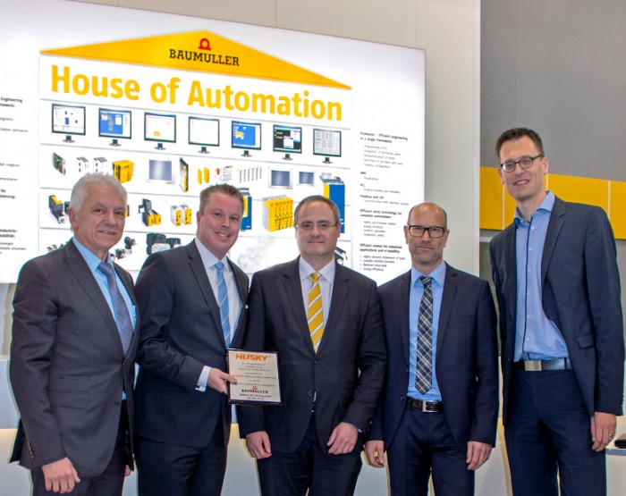 """Supplier of the year Husky Baumüller 2016 During the presentation of the award """"Supplier of the year 2015"""" at the Hannover Messe 2016, from left to right: Eugene Wojciechowski (Husky), Randy Auld (Husky), Andreas Baumüller (Baumüller), Stephan König (Husky), Roel Hoogveld (Husky)Photo by Baumüller Nürnberg GmbH"""