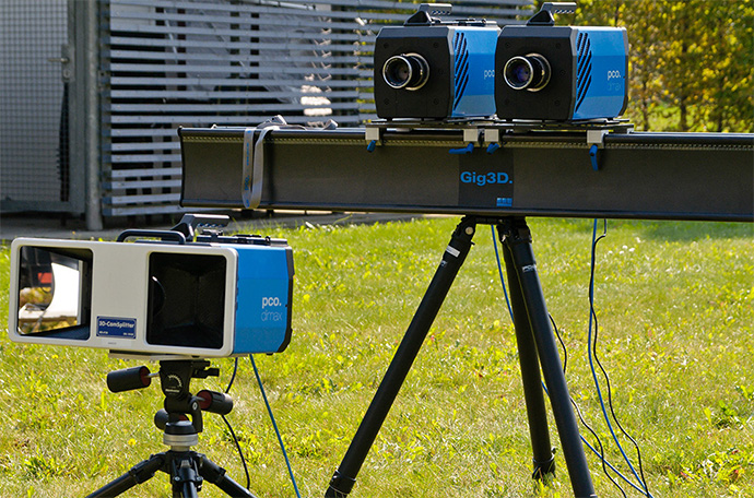 Two different stereo 2D set-ups with pco.dimax highspeed cameras. In front there is a mirror set-up, where two images are recorded in the same image sensor side-by-side. While the set-up on a stereo bar behind uses two synchronized pco.dimax highspeed cameras to record stereo images at higher resolutions.